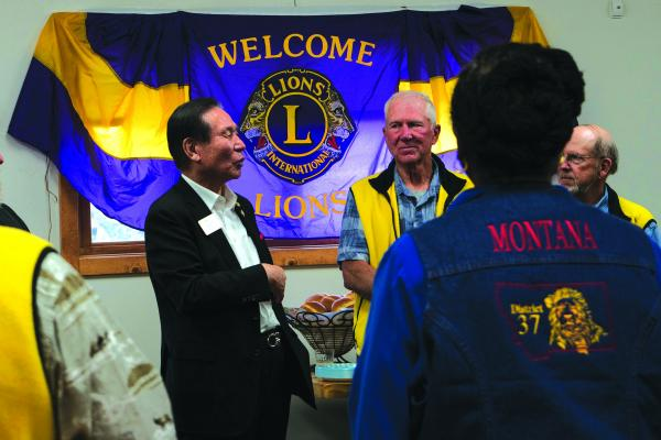 First vice president of the Lions Club International, Dr. Jung-Yul Choi (left) addresses Lions Club members before a celebratory potluck at the Ennis, Montana senior center Wednesday, May 15.
