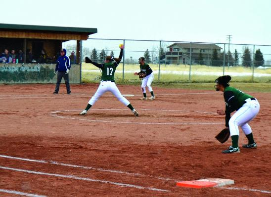 Ennis's Whitney McKitrick (12) winds up for a pitch against the Deer Lodge Lady Wardens on March 29.