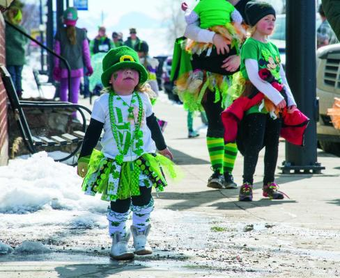 Competitors and spectators alike donned their best festive green costumes for Sheridan's Leprechaun Dash. Prizes were given out for fastest times in the 5k, 1-mile and 100-yard races, as well as for best costume.