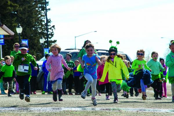 Leaders of the Leprechaun Dash 100-yard kids' dash focus on the finish line as they race down Main Street in Sheridan on Saturday, March 16.