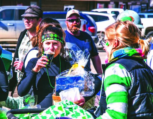 Prizes for best costume and age group awards for the Leprechaun Dash were given out on Saturday, March 16, as older finishers enjoyed beer from Ruby Valley Brew to celebrate St. Patrick's Day and raise money for New Kids on the Block daycare.