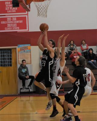 Harrison/Willow Creek's Lane Buus drives down the lane for two. (Photo courtesy Andi Christensen)