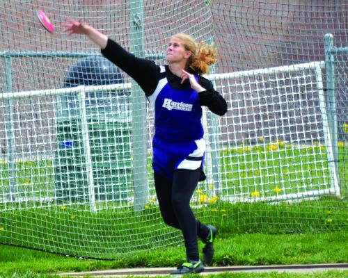 Kayley Christensen of Harrison throws a discus.