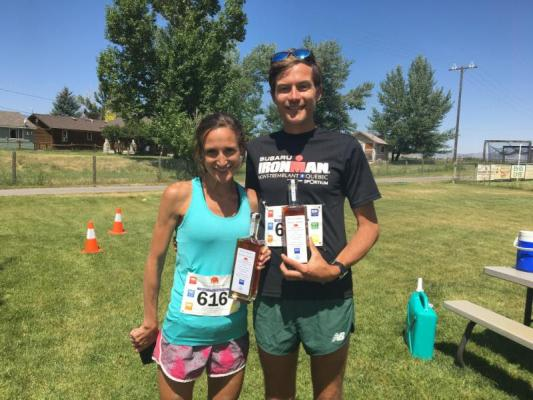 Vanessa Garlick (left) and Kevin Hartstein hold their prizes: commemorative bottles of Willie's reserve bourbon. Garlick won both the Madison and Big Sky marathons on July 21 and 22, while Hartstein placed second in the Madison Marathon and won the Big Sky Marathon. (S. Korsmoe photo)