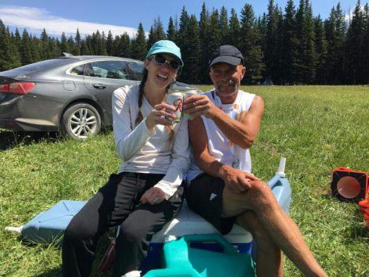 - Lynda Andros-Clay and Eric Huff enjoy a post-race beverage after the Big Sky marathon on Saturday, July 21. (S. Korsmoe photo)