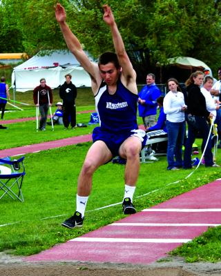 Luke Cima of Harrison, triple jumping.