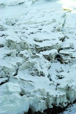 Huge chunks of ice like these collecting and damming the flow of the river are the source of ice gorges