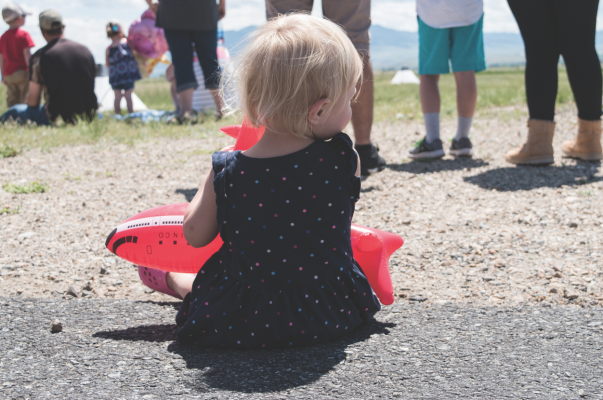 Maggie Dawson, 2, from Twin Bridges waits for the pilots' games to begin at the Twin Bridges Airport Fly-In Car Show during her first airshow June 15.