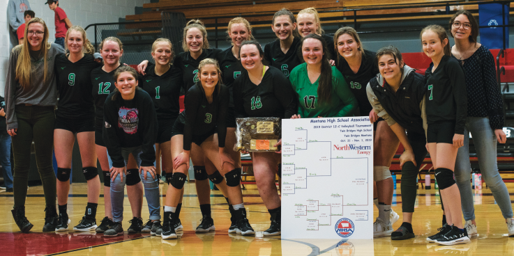 After winning all their matches in Twin Bridges at the 2019 District 12C Volleyball Tournament, the Ennis Mustangs retain their championship title Nov. 1. Photo by Hannah Kearse
