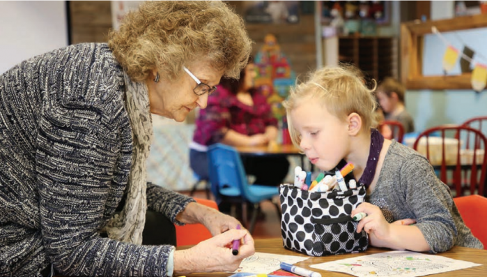 Pearl Hawkins colors with preschooler Kaylee Homen Jan. 10, 2020. Hawkins said she finds coloring relaxing, and enjoys the activity with students because she learns about them while they work together. Photo credit: ANDI BOURNE/SEELEY SWAN PATHFINDER