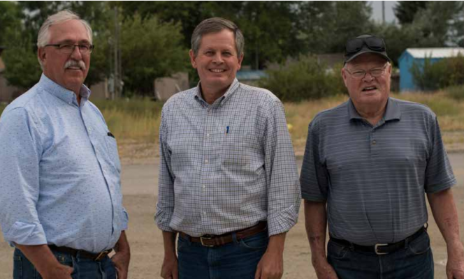 Madison County Commissioner Jim Hart, U.S. Senator Steve Daines and Madison County Commissioner Ron Nye outside the Twin Bridges Community Building Aug. 27. PHOTO BY HANNAH KEARSE