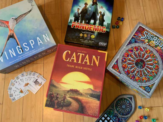 Wingspan, Pandemic, Sagrada and Catan shown here. PHOTO BY KEELY LARSON