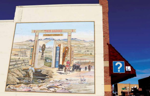 The mural on the side of the library was painted by local painter Jim Shirk. Shirk's goal was to create a mural that encompassed all the beautiful elements of the Twin Bridges area. PHOTO BY JOLENE PALMER