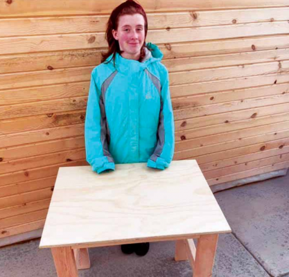 It's a family affair. Davies' daughter Reagan helps her dad create the desks. PHOTO COURTESY DENNIS DAVIES