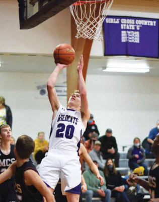 Harrison junior, Kyle Homner, puts up a shot against the Manhattan Christian Eagles. Homner was Harrison's high scorer in their Thursday night game against the Ennis Mustangs. PHOTO COURTESY ANDREA CHRISTENSEN