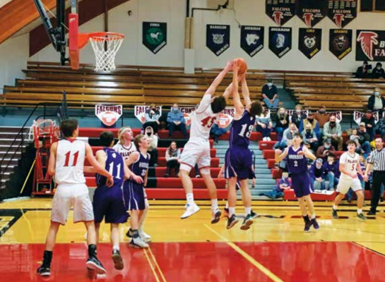 Matthew Kaiser attempts one of many points made during the Feb. 19 win against Harrison in Round Two of district playoffs. PHOTO COURTESY TWIN BRIDGES SCHOOL DISTRICT