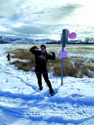 Sheridan junior Micara Devereaux marks the course for the 5k race she and fellow FCCLA students hosted as their chapter service project. The team hopes to make it to the national conference in Anaheim, California this June.