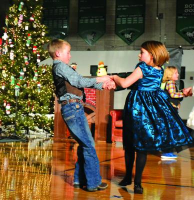 "Ennis Elementary's second grade class performed ""Baby, It's Cold Outside,"" complete with dancing choreographed by Ashton Olson, at the school's annual Christmas concert. (R. Colyer)"
