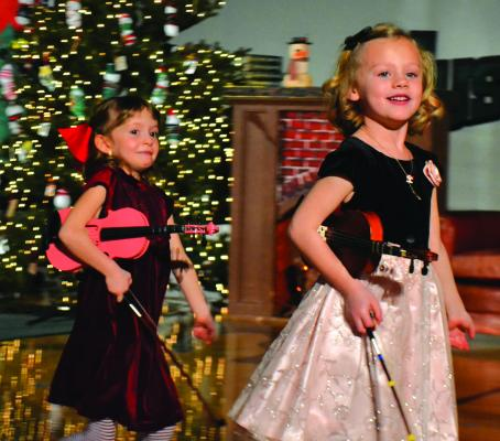 """Young violinists served as accompanists, along with piano teacher Vickey Gordon, as the preschoolers of Ennis Community Children's School sang """"Jingle Bells"""" to kick off the Ennis Christmas Concert on Monday, December 17. (R. Colyer photos)"""