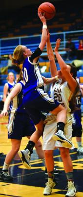 Harrison's Maddison Christiansen shoots over the top of a Lima defender at the 12 C district tournament on Friday, February 15. Harrison beat Lima 42 - 23 in that game and would move on to play Twin Bridges the next day. (A. Christensen )