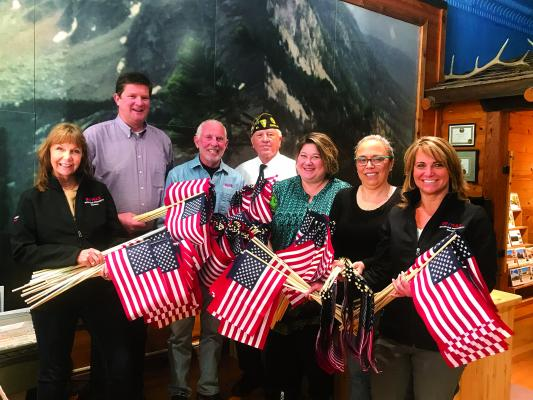 RE/MAX Mountain Property was honored to have donated 300 flags to be placed on Madison Valley veteran's gravesites for the observance of Memorial Day. Ennis American Legion Post 65 Commander Lee Sargent proudly accepted this donation from the RE/MAX Mountain Property Team: Pam Menzel - agent, Lincoln Roberts - Broker, Bill Mercer - Broker/Owner, Corinna Christensen - agent, Kim Foreman - agent, Laura Gilmore – Broker and Quinn Diamond - owner (not pictured).  (Submitted)