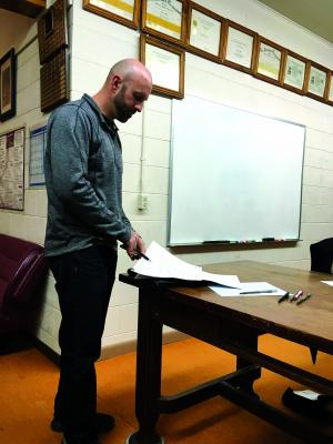 Great West Engineering's Jeremiah Theys, PE explains  the  6th Ave. sidewalk project and how it might be modified to suit the town's needs at Twin Bridges town council meeting March 12
