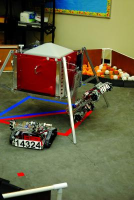 A robot climbs up the side of a structure to dock like a Mars Rover might do.