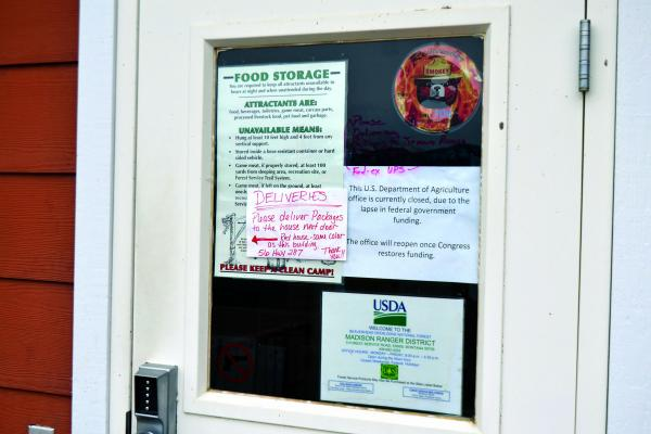 A sign at the Ennis U.S. Forest Service office lets visitors know that the office will be closed until the partial federal government shutdown is lifted. The Forest Service, overseen by the U.S. Department of Agriculture, is unfunded during the shutdown. (R. Colyer)