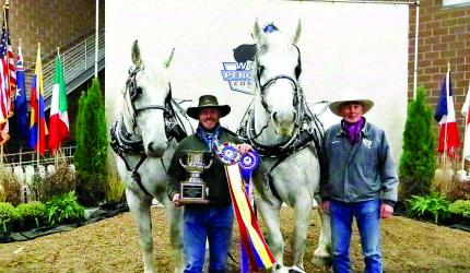 Matt Clover, his Percherons, Salt and Pepper, his dog Cinch, and long-time supporter Loren Tucker (Submitted)