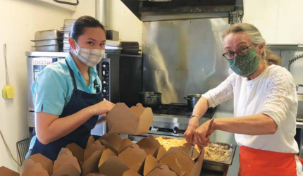 Jade Fuqua and Janet Marsh preparing meals at the Shovel and Spoon for the Sheridan Senior Center. PHOTO COURTESY OF JANET MARSH