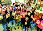 Members of the Ennis High School FCCLA club gave up their lunch hour on Friday, November 16, to put together turkey soup packets for the Ennis Food Bank's Thanksgiving baskets. It is one of the club's monthly projects, coupled with nearly four dozen pumpkin pies made by the EHS culinary arts classes. (Jamie Diehl)