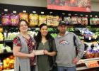 Madison Foods owner Chris Gentry, left, presents a check for $1,195 to Ennis High School junior Alyssa West at the grocery store last Friday. The donation will help West attend a medical camp at St. John's University in New York this summer. On the right is store manager Blake Leavitt.