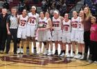 The Lady Falcons celebrate their first-place victory after defeating the Ennis Mustangs, 51-36. (Photo courtesy Kari Montgomery)