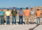 The crew who put the new Giem Bridge together stand on their work Sept. 21. From the left: Tom Miller, TJ Renolds, Chris Mehring, Madison County Commissioner Ron Nye, Josh Harris, Clyde Nichols, Kipp Harris. PHOTO BY HANNAH KEARSE
