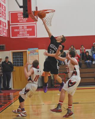 Derik DeFrance grabs two points for the Wildcats. (Photo courtesy Andi Christensen)