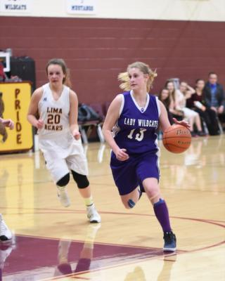 Kayley Christensen brings the ball down the court during the game in Lima on Feb. 3. (Photo courtesy Andi Christensen)