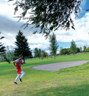 Zane Carter, Twin Bridges cross country, runs during the Dillon Invitational on Saturday. PHOTO COURTESY OF HANNAH KONEN