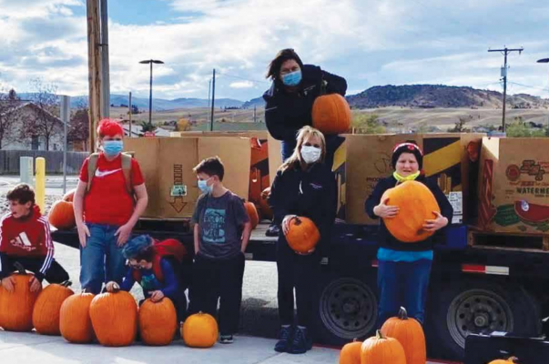 The goal was to provide pumpkins primarily for elementary through sixth grade students. This was accomplished and extras were given to Ennis Community Children's School students and a few high schoolers. PHOTO COURTESY OF CORINNA CHRISTENSEN