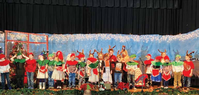 """""""The best way to spread Christmas cheer is singing loud for all to hear,"""" Buddy the Elf. Harrison School's The Little Reindeer play was filmed on Dec. 17. Area schools adapted to Covid and found ways to celebrate. See more on the Community page, B1. PHOTO COURTESY OF KATHLEEN JORGENSON/HARRISON SCHOOL"""