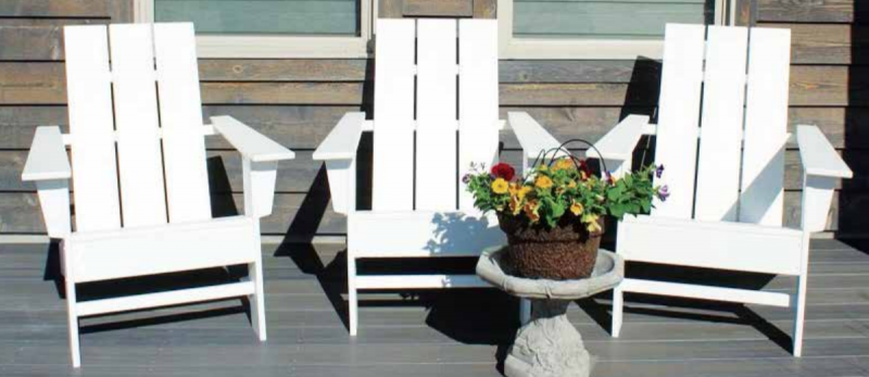 These white Adirondack chairs are serving as the blank canvases for local artists to work their creative magic on this summer. PHOTO COURTESY ELYSSE CONKLIN