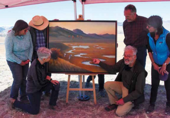 """NorthWestern Energy commissioned the """"Restoring Our Waters"""" artwork to celebrate the success of the O'Dell Creek restoration project. Left to right, kneeling, NorthWestern Energy Director Environmental & Lands Permitting & Compliance Mary Gail Sullivan and renowned Montana artist Monte Dolack. Left to right, standing, Madison Farm to Fork Chair Kaye Suzuki, Granger Ranches owner Jeff Laszlo, NorthWestern Energy Chief Executive Officer Bob Rowe and Madison Farm to Fork GROWW Coordinator Janet BeanDochnahl."""