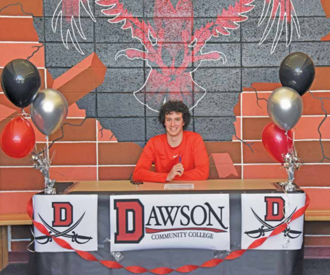 Charlie Kruer signing his letter of intent to play basketball for the Dawson Community College Buccaneers on Thursday, May 13. PHOTO COURTESY JODY SANDRU