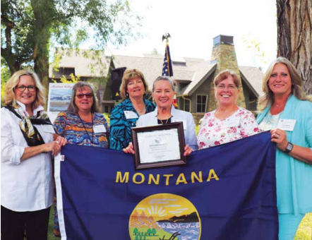 Board members of the Madison Valley Woman's Club hold the flag gifted to them by Gov, Gianforte. The flag flew at the State Capitol in Helena on August 4. PHOTO BY JOLENE PALMER