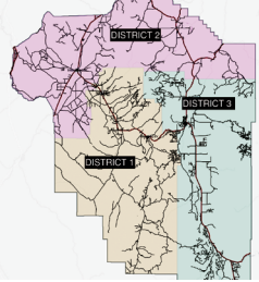 Madison County's districts. District 1, in tan, is managed by Commissioner Dan Allhands. District 2, in purple, is managed by Commissioner Ron Nye, and District 3 is managed by Commissioner Jim Hart. MADISON COUNTY GIS MAP