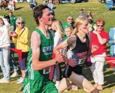 (LEFT) Ennis JV runner Eli Beardsley finishes seventh at the Bridger Creek Golf Course meet on Sept. 11 with a PR of 18:56.