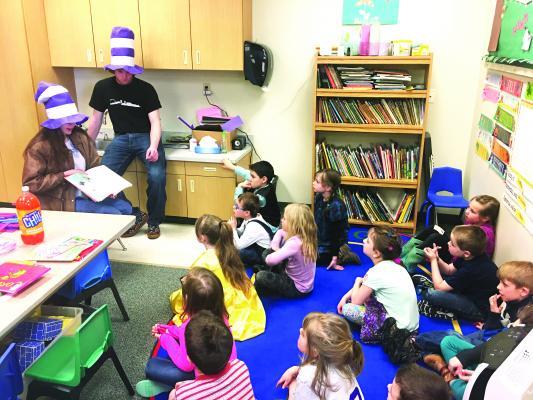 Sandy Moore & Zane Bowey read Horton Hatches the Egg to the Kindergarten class.