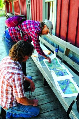 Andy Thomas and Darlene Tussing look over maps of the proposed route at the train station in Nevada City. Thomas and Tussing are the prime drivers behind creating the trail. (J. Taylor photo)