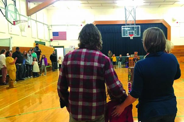 """Kindergarteners and their families closed out the students' annual Thanksgiving performance with two verses of """"My Country 'Tis of Thee"""" on Monday night, November 19."""