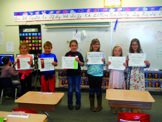 Sheridan Junior Duck Stamp artists - Every year the 3rd grade art class in Sheridan studies waterfowl and wetlands before drawing a realistic portrait of one particular duck or goose species. Students sometimes choose to enter their artwork in the Montana Junior Duck Stamp Contest. They may compete against up to 100 other students in their age category. This year Sheridan sent six entries. Every student received a Certificate of Appreciation for entering their artwork. Above (left to right) are: Hazalin Mad