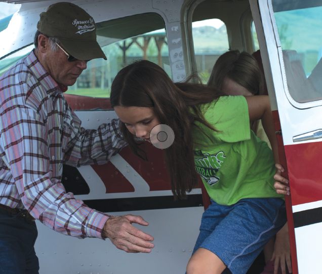 Sisters Ellie Brown,10, and Maelin Brown,8, of Sheridan step out of a Cessna 182 Skyline after their first Young Eagle Flight at the Fly-In Car Show at the Twin Bridges Airport June 15.